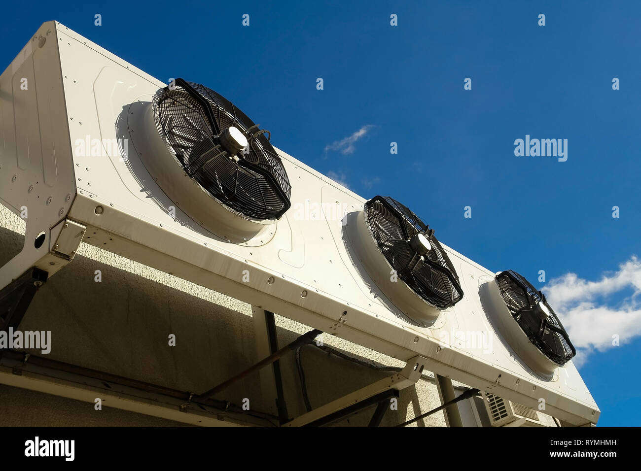 Industrial air conditioning system on the wall outdoors. Stock Photo