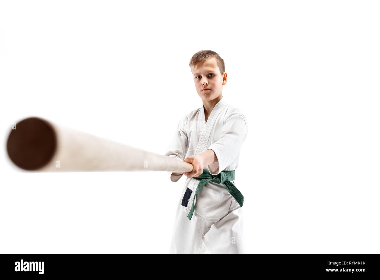 33aa93cf65 Teen boy fighting with wooden sword at Aikido training in martial arts  school. Healthy lifestyle