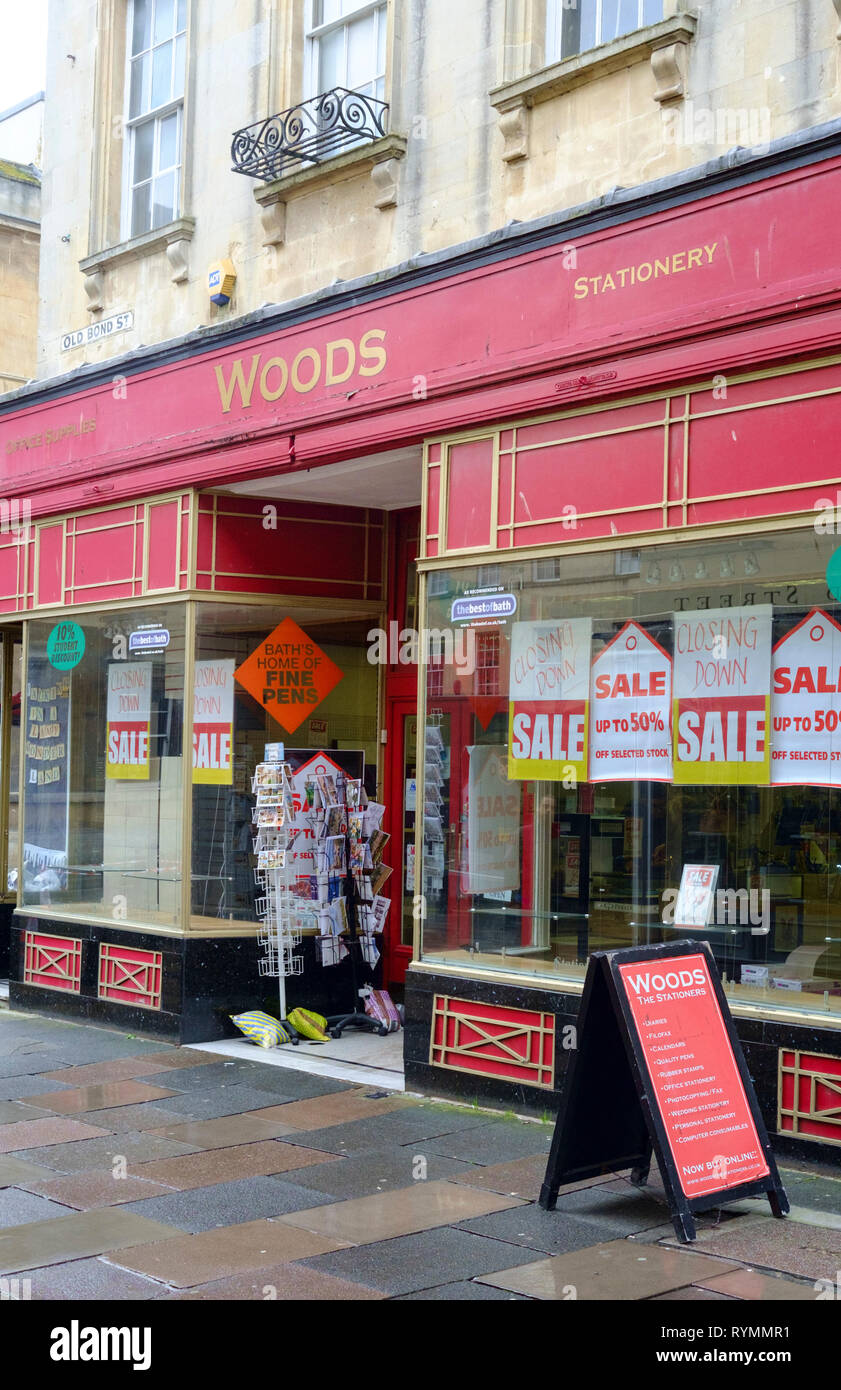 Shop fronts in the city of Bath somerset UK Woods the Stationers now closed - Stock Image