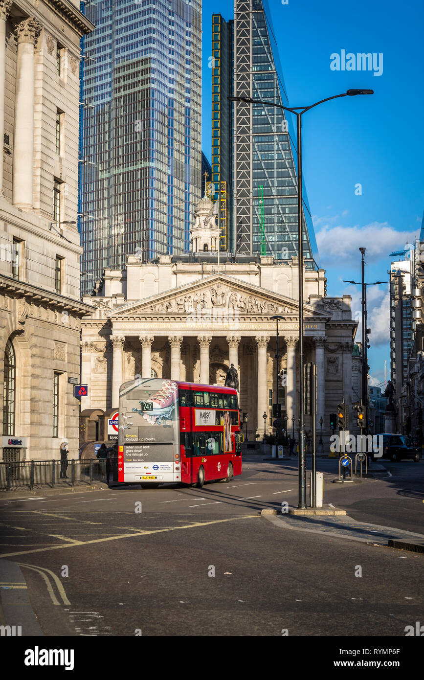 Bus passing by the Royal Exchange building, City of London, England, UK Stock Photo