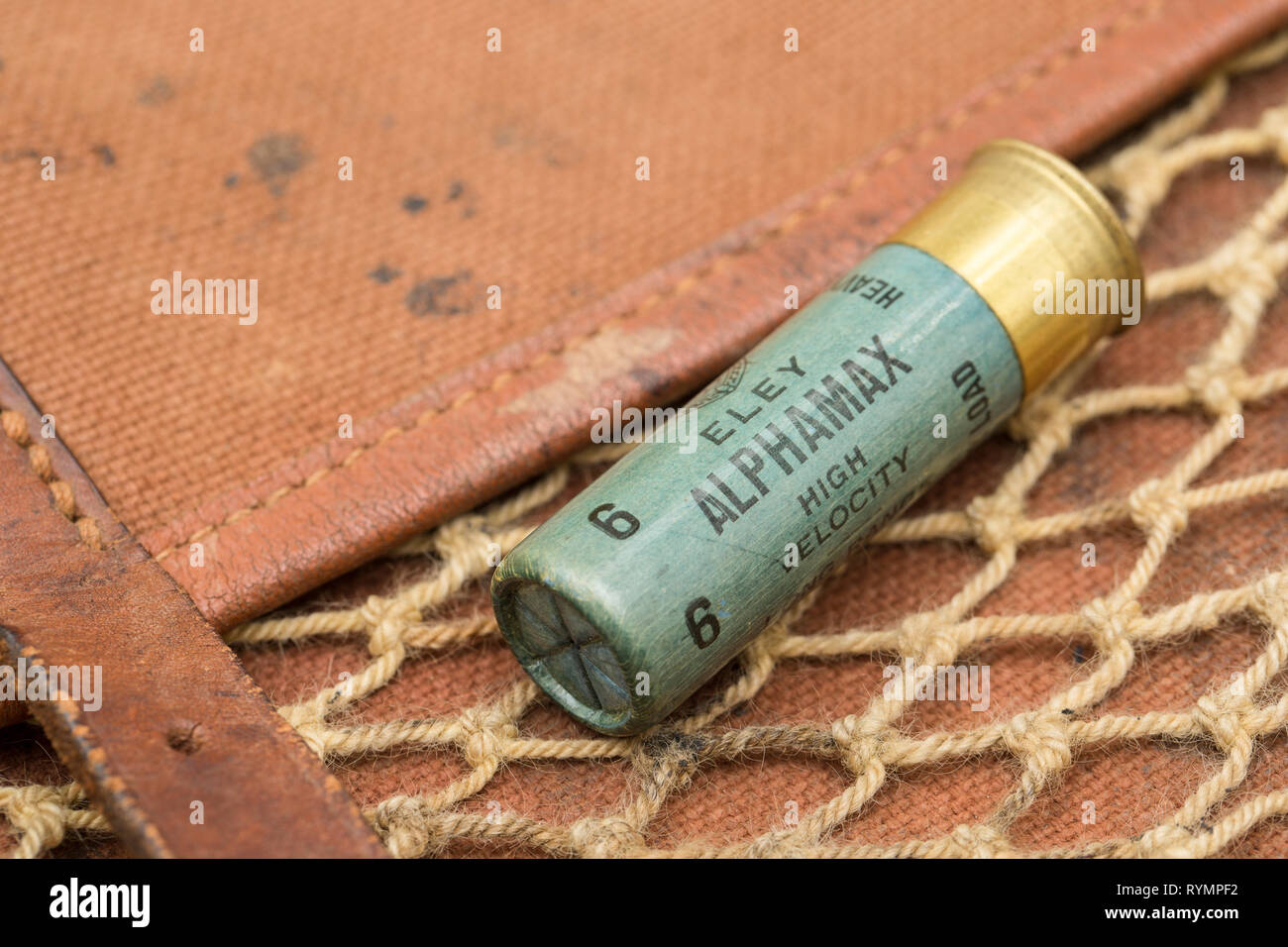 An old paper cased Eley Alphamax high velocity 16-bore, or