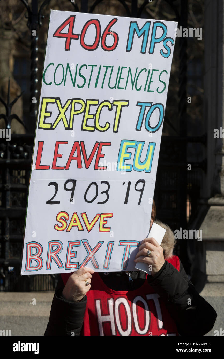 On the day that MPs in Parliament vote on a possible delay on Article 50 on EU Brexit negotiations by Prime Minister Theresa May, a Brexiteer activist protests outside the House of Commons, on 14th March 2019, in Westminster, London, England. - Stock Image