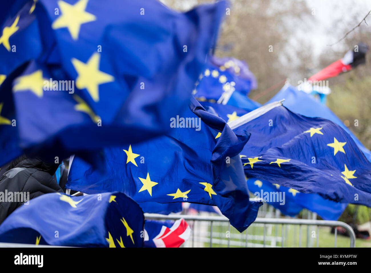 Flags of the European Union flying at a brexit march in London - Stock Image