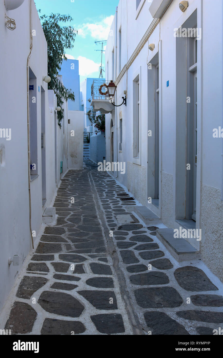 Narrow alley in Parikia, Cycladic Islands, Paros, Greece - Stock Image