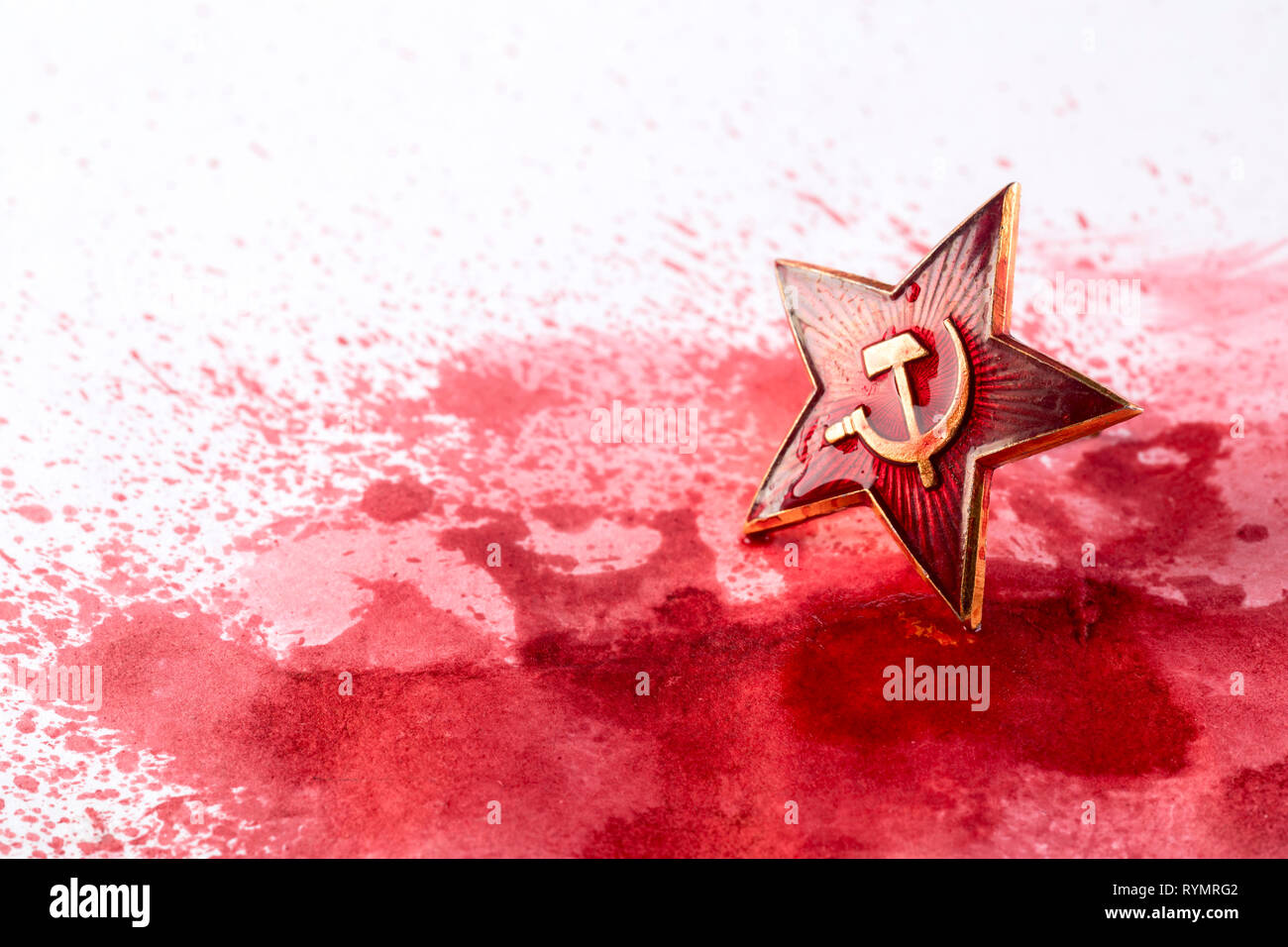 Soviet red star badge in blood Stock Photo