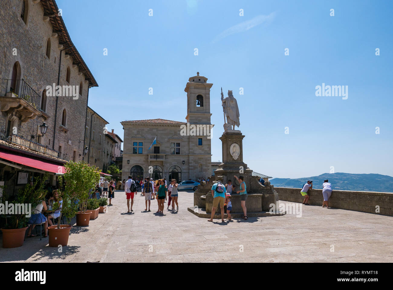 SAN MARINO, REPUBLIC OF SAN MARINO - 6 AUGUST 2018: Tourists stroll in  the  Piazza della Libertà in San Marino - Stock Image