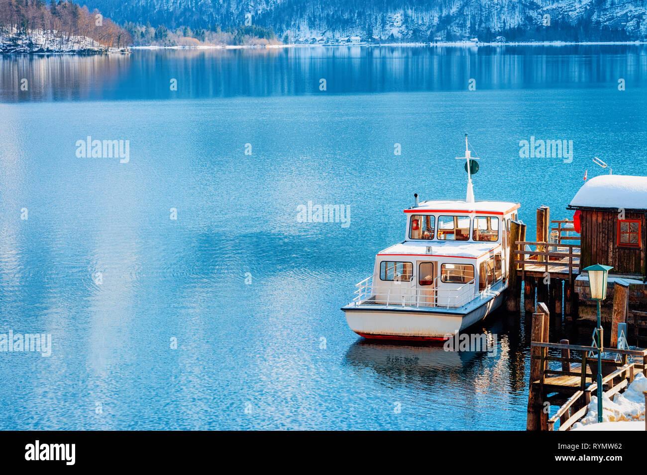 Touristic ferry on Hallstatt Lake near Salzburg in Austria, Europe. Winter in Salzkammergut. Travel to Austrian city with lake at Christmas. Alpine La Stock Photo