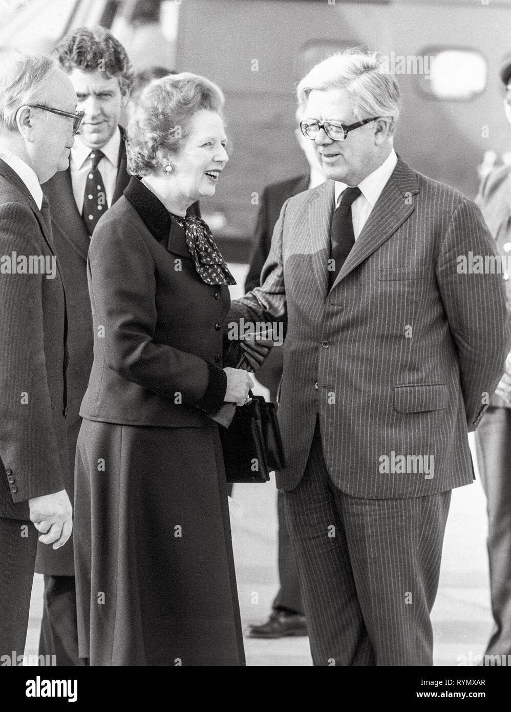 Prime minister Margaret Thatcher leaving London's Heathrow to Moscow with Foreign secretary Geoffrey Howe. - Stock Image