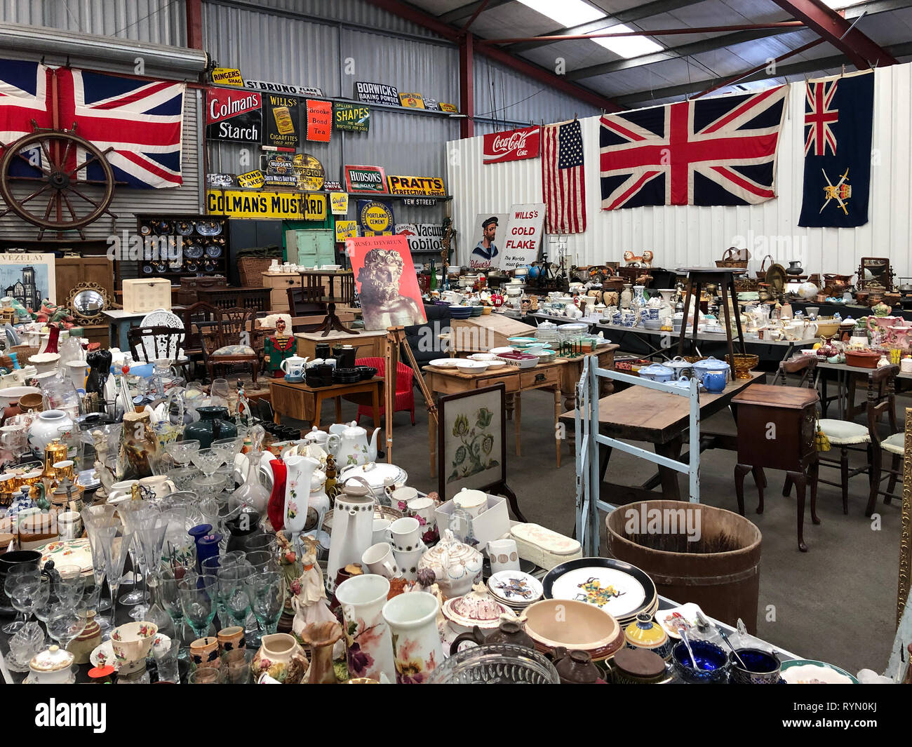 Antiques Market or Junk Shop full of old items for sale. Stock Photo