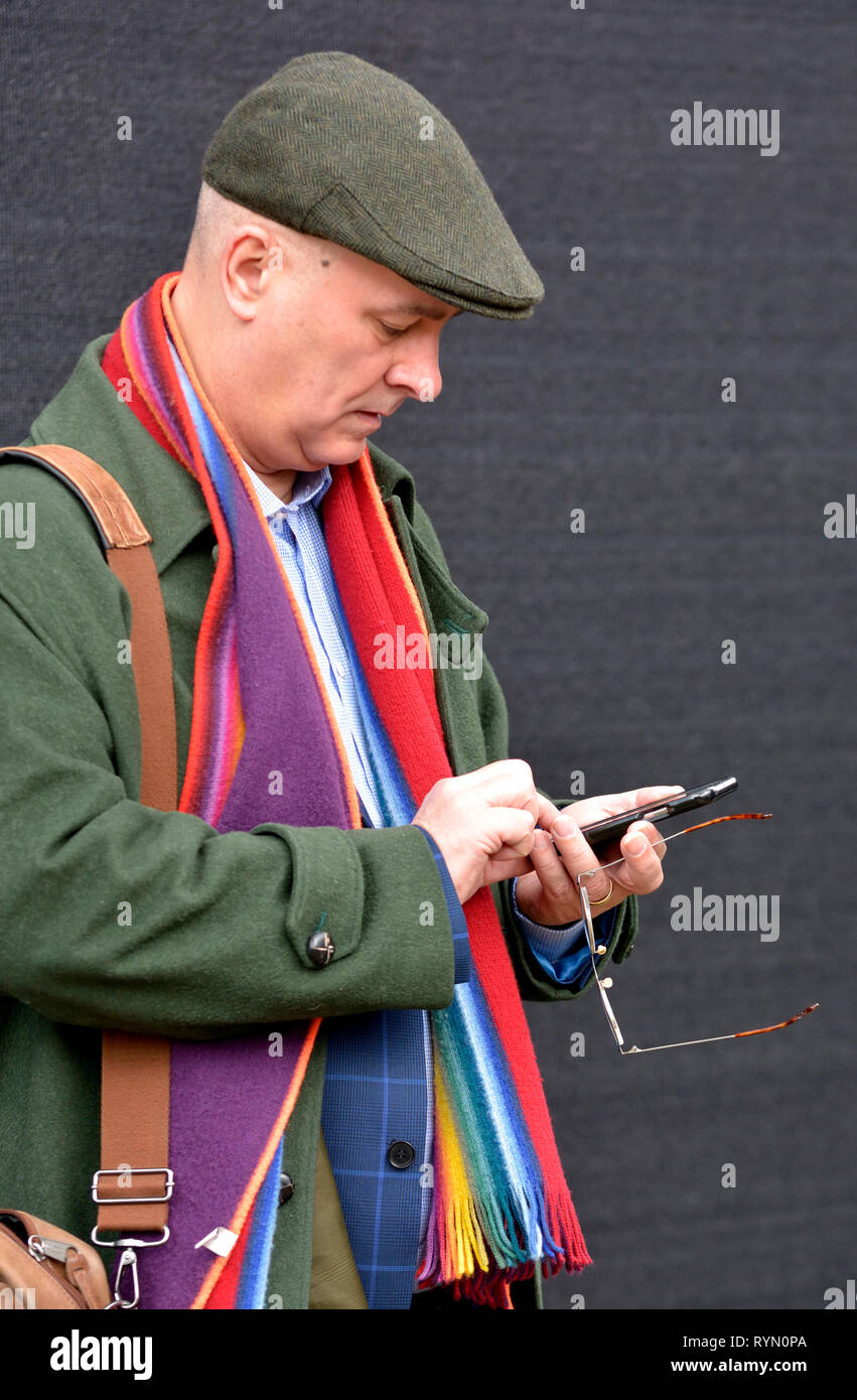 Iain Dale, right wing broadcaster, political commentator, blogger, publisher, and former Conservative candidate, on his mobile phone in Westminster, M - Stock Image