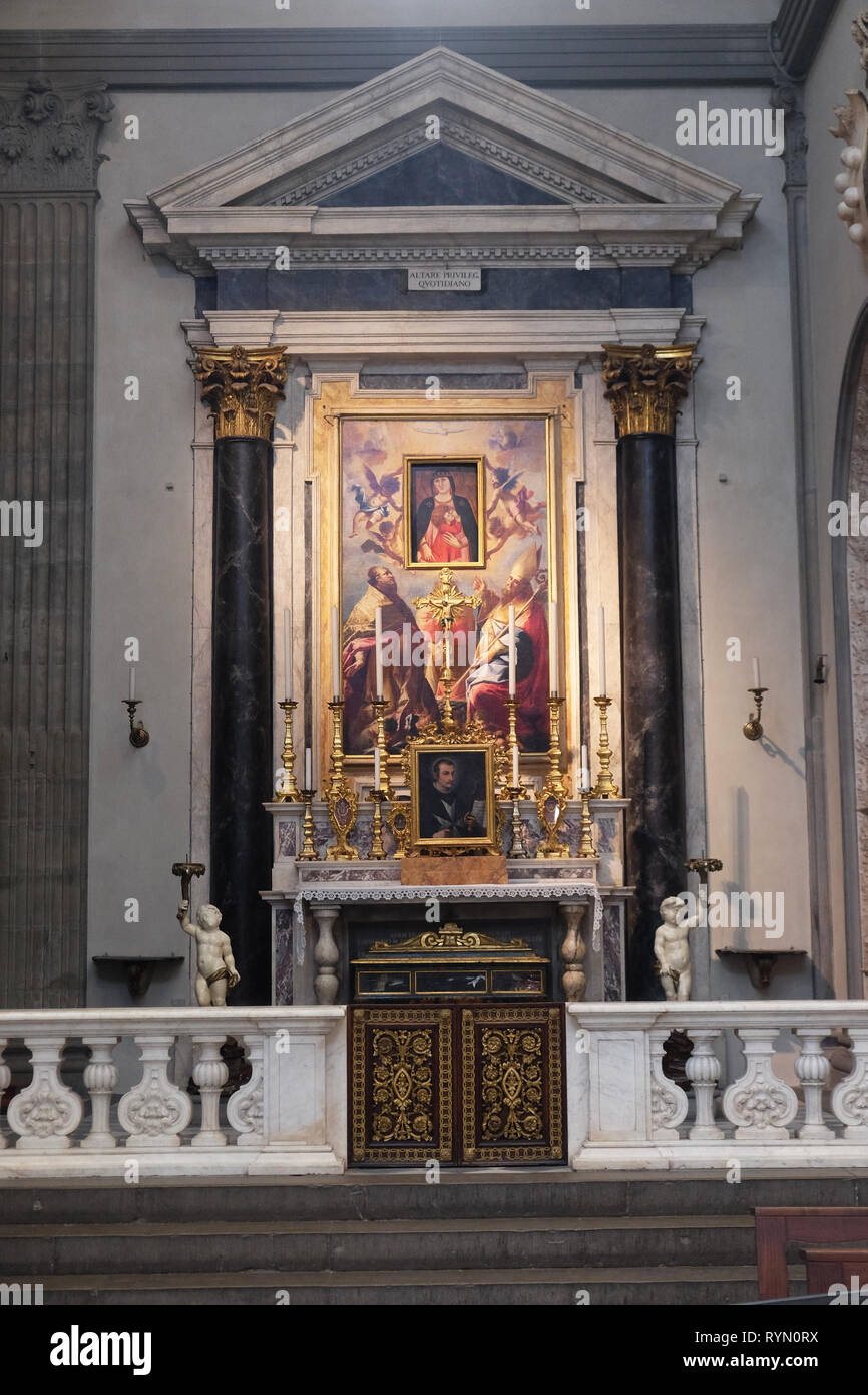 Saints Zenobius and Ambrose and angels surrounding the Madonna, altar in the Basilica di San Lorenzo in Florence, Italy - Stock Image