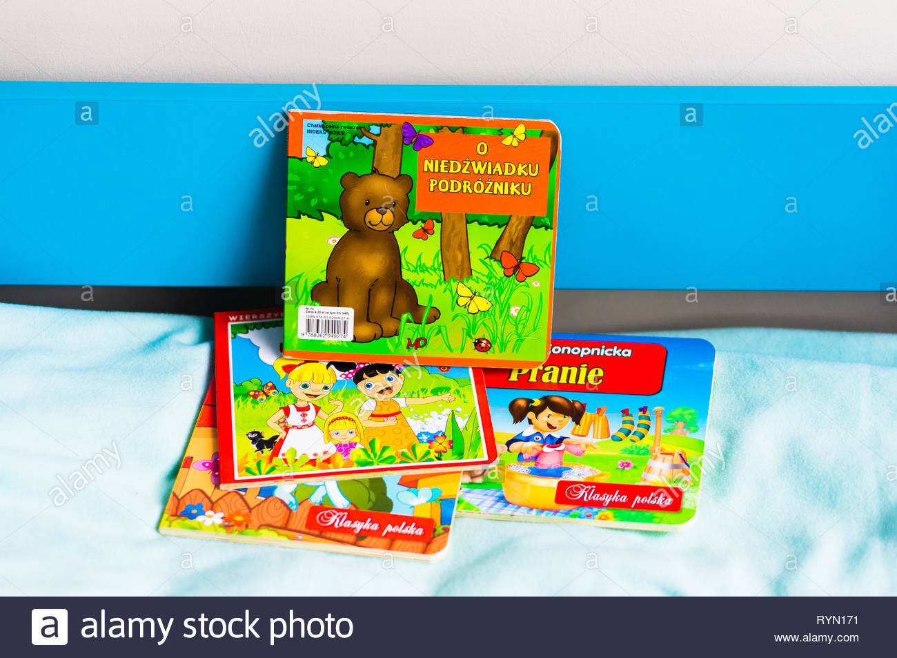 Poznan, Poland - November 18, 2018: Colorful Polish child book about a bear on a bed. Stock Photo