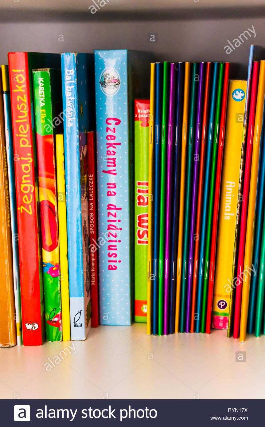 Poznan, Poland - November 18, 2018: Row of colorful Polish child books on a shelf. Stock Photo