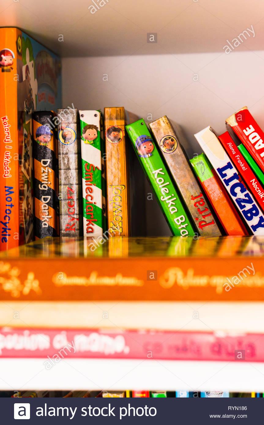 Poznan, Poland - November 18, 2018: Row of colorful child books in Polish on a shelf. Stock Photo
