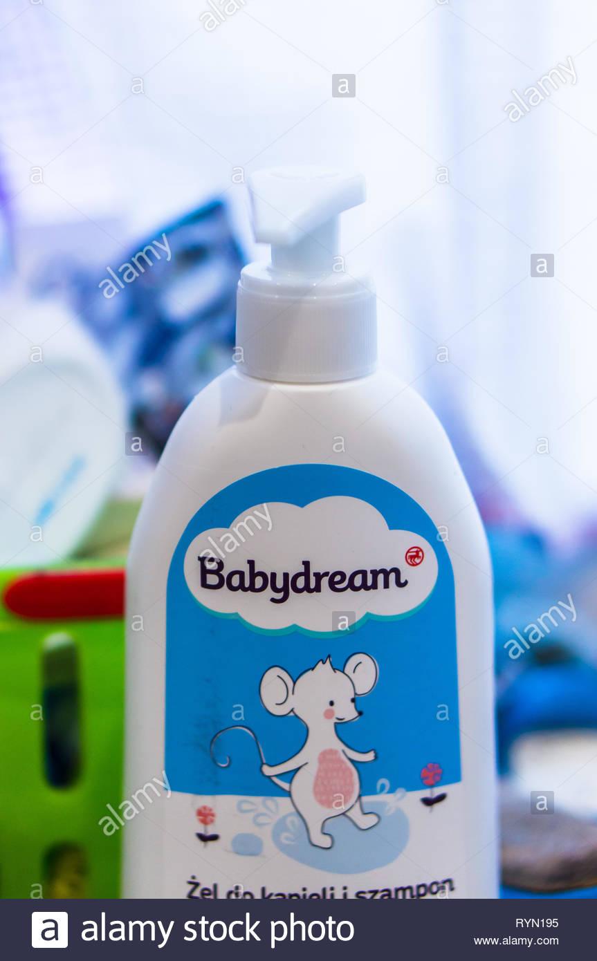 Poznan, Poland - November 18, 2018: Polish Babydream baby bath gel in a plastic bottle in a bathroom by a window. Stock Photo