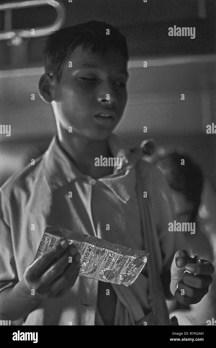 17/8 Blind young vendor on train sells throat lozenges as a cure-all 1981 - Stock Image
