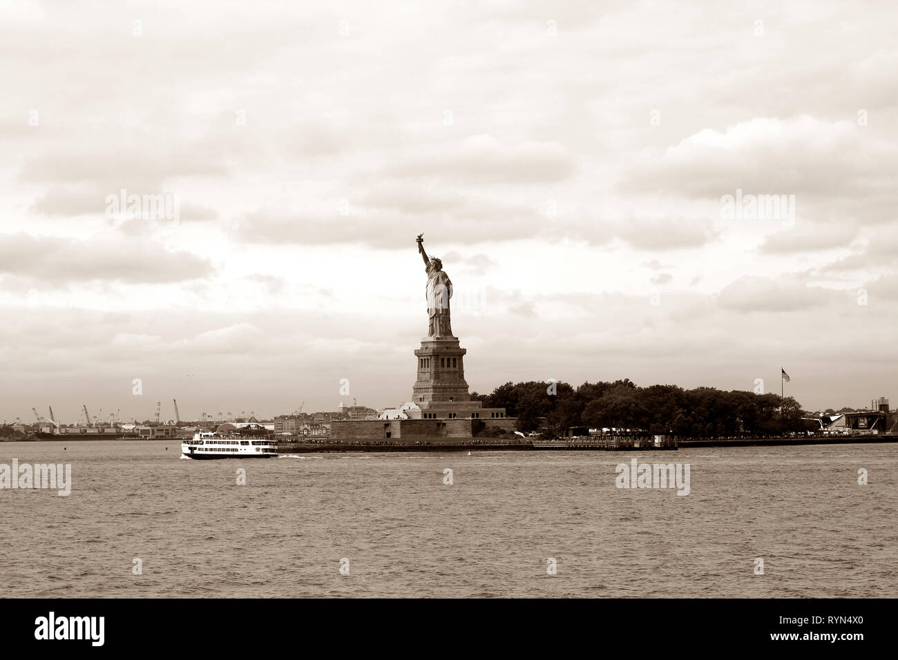 The Statue of Liberty on Liberty Island in the New York Harbor, New York City, USA in sepia tones - Stock Image