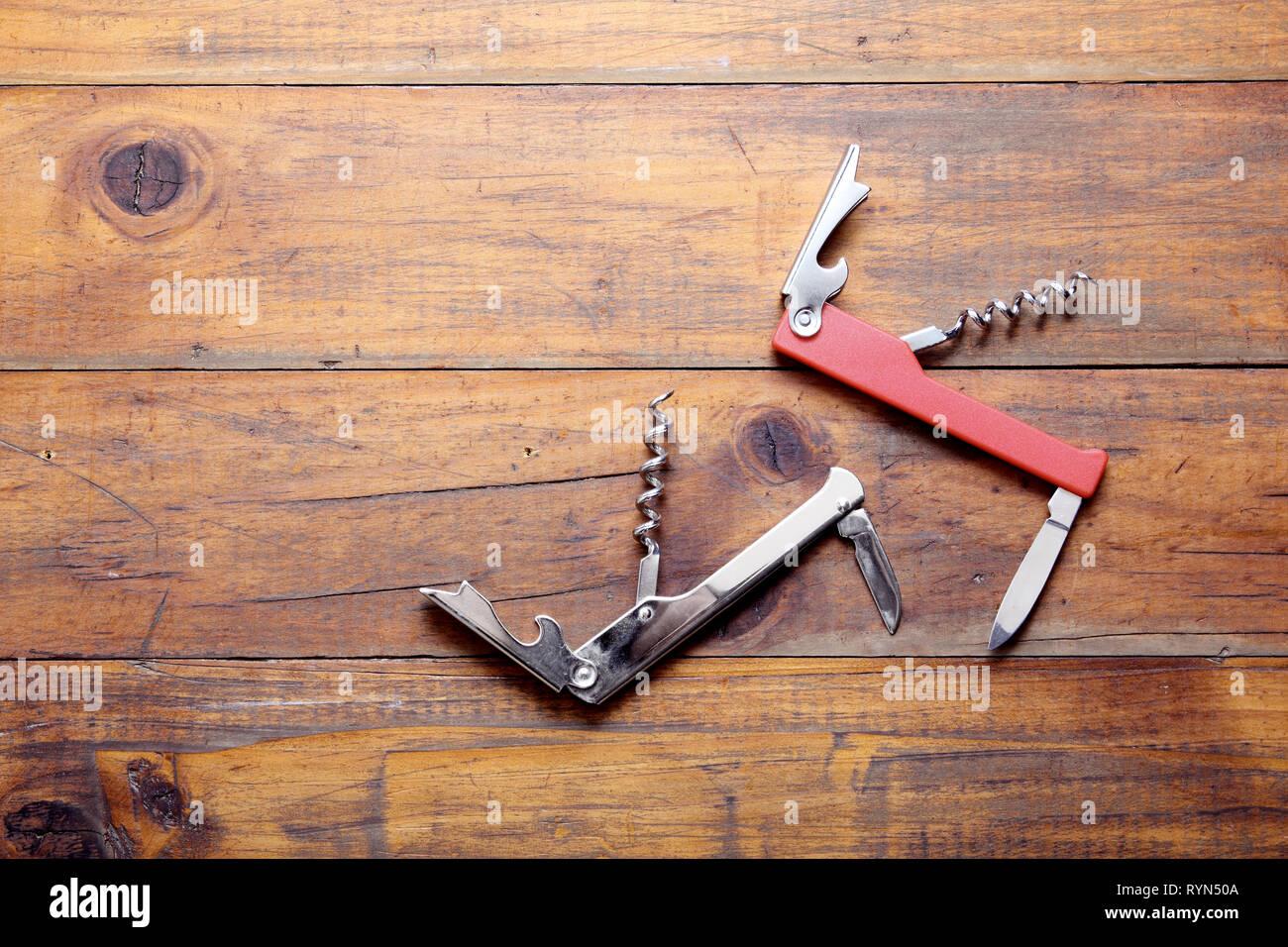 Multi Purpose Knife on Wooden Background - Stock Image