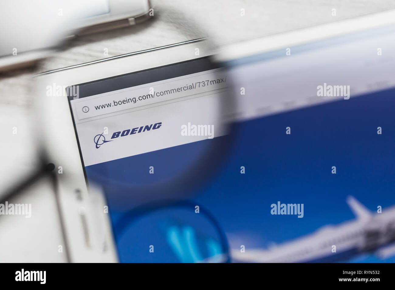 Bishoftu, Ethiopia - March 15, 2019: Boeing Company, 737 max, official website homepage under magnifying glass. Concept Boeing Company, 737 max - Stock Image