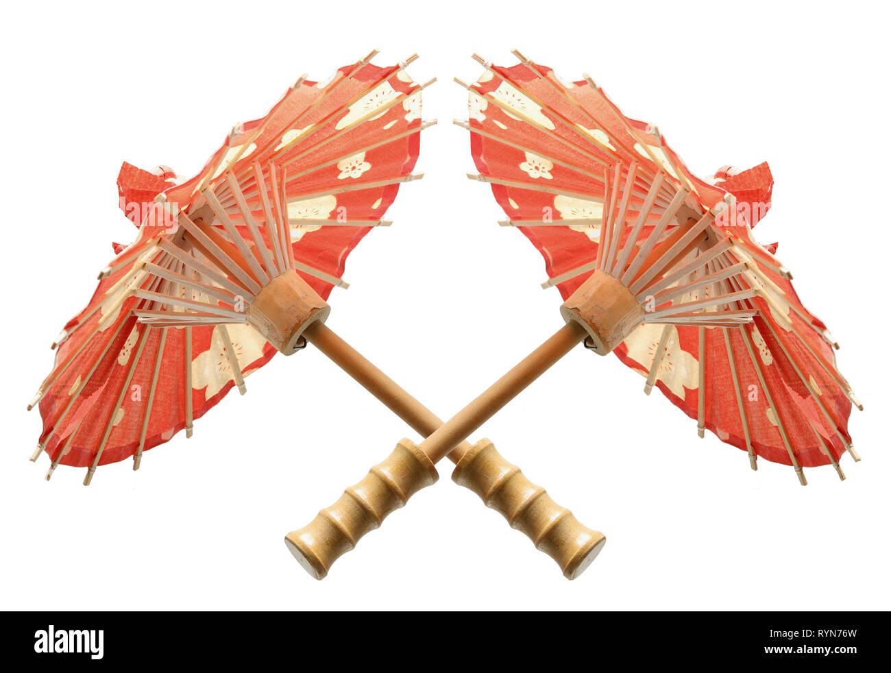 Miniature Paper Umbrellas on White Background - Stock Image