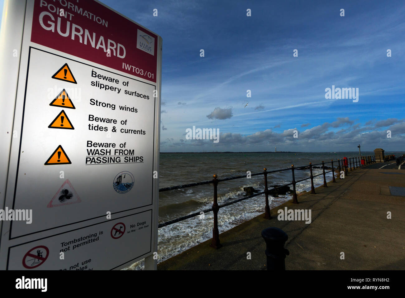 warning sign,beware of wash from, ships,strong,winds,slippery,surfaces,tides, currents,passing,tombstoing,not, permitted,no,dogs, Gurnard, Isle of Wig Stock Photo