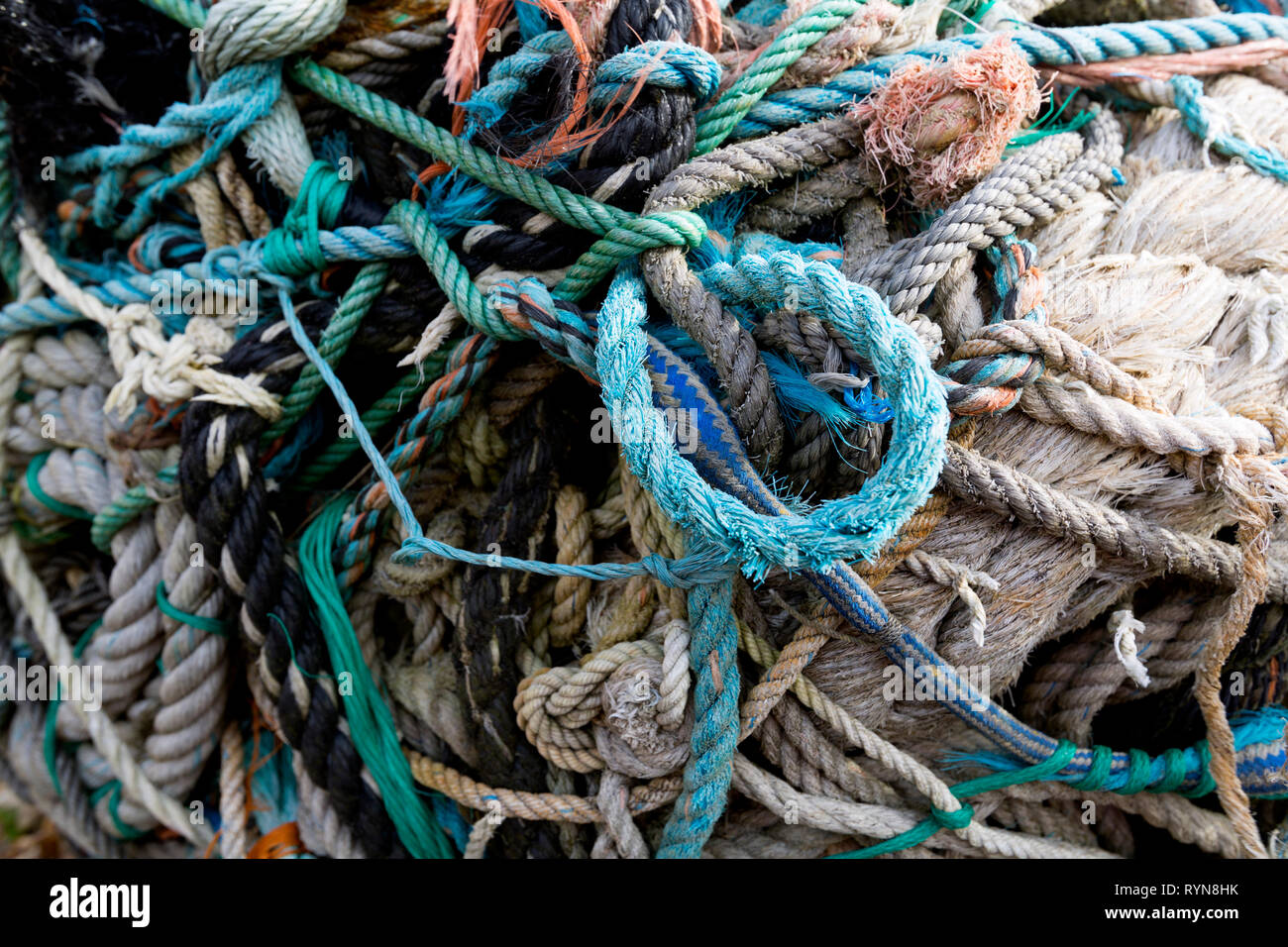 large,ball,of,rope,discarded,in,the,sea,washed,up,various,diameters,fishing warps,ropes,nets, - Stock Image
