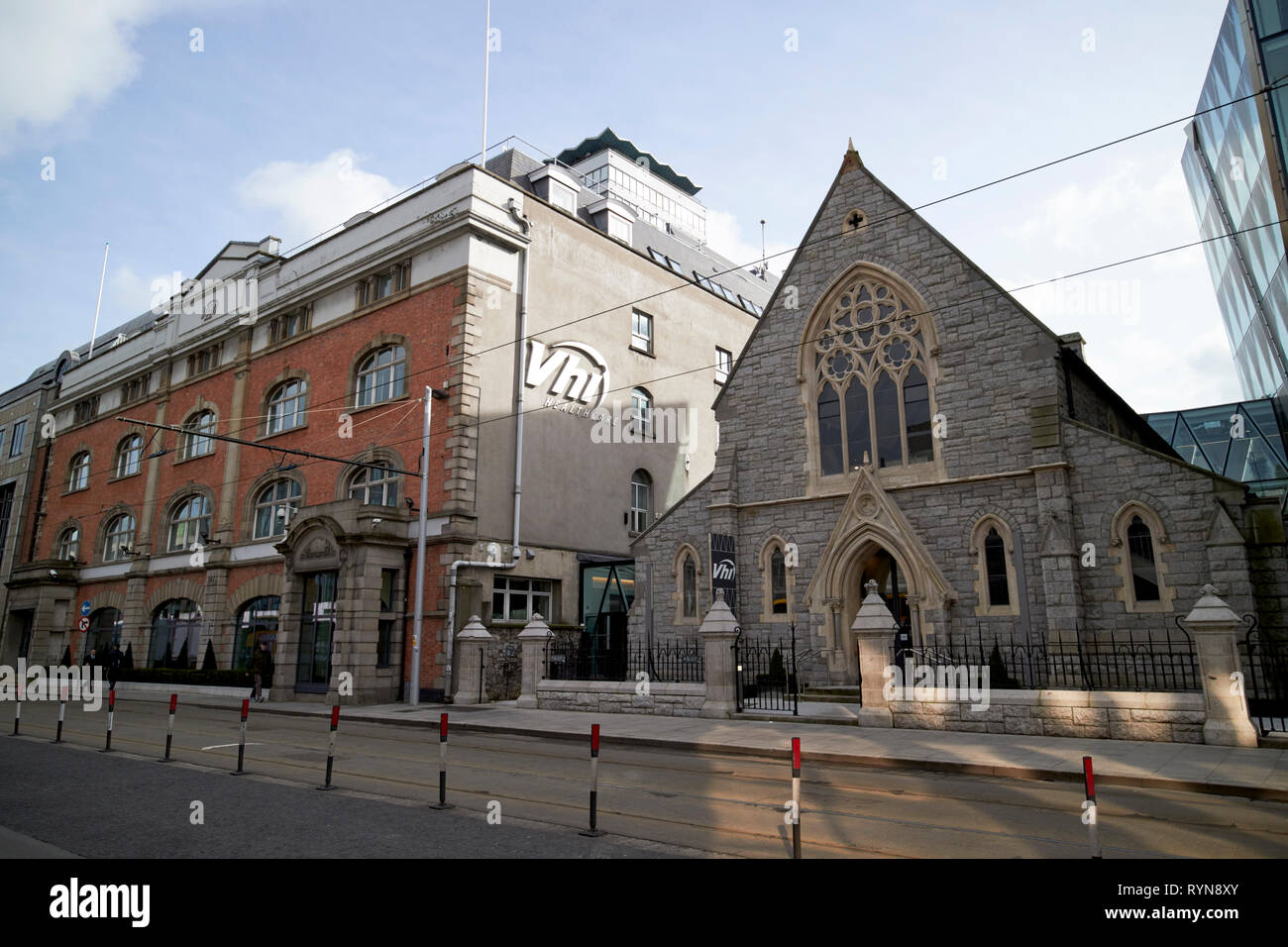 VHI healthcare building and old scots presbyterian church ormond quay and scots church Dublin Republic of Ireland Europe - Stock Image