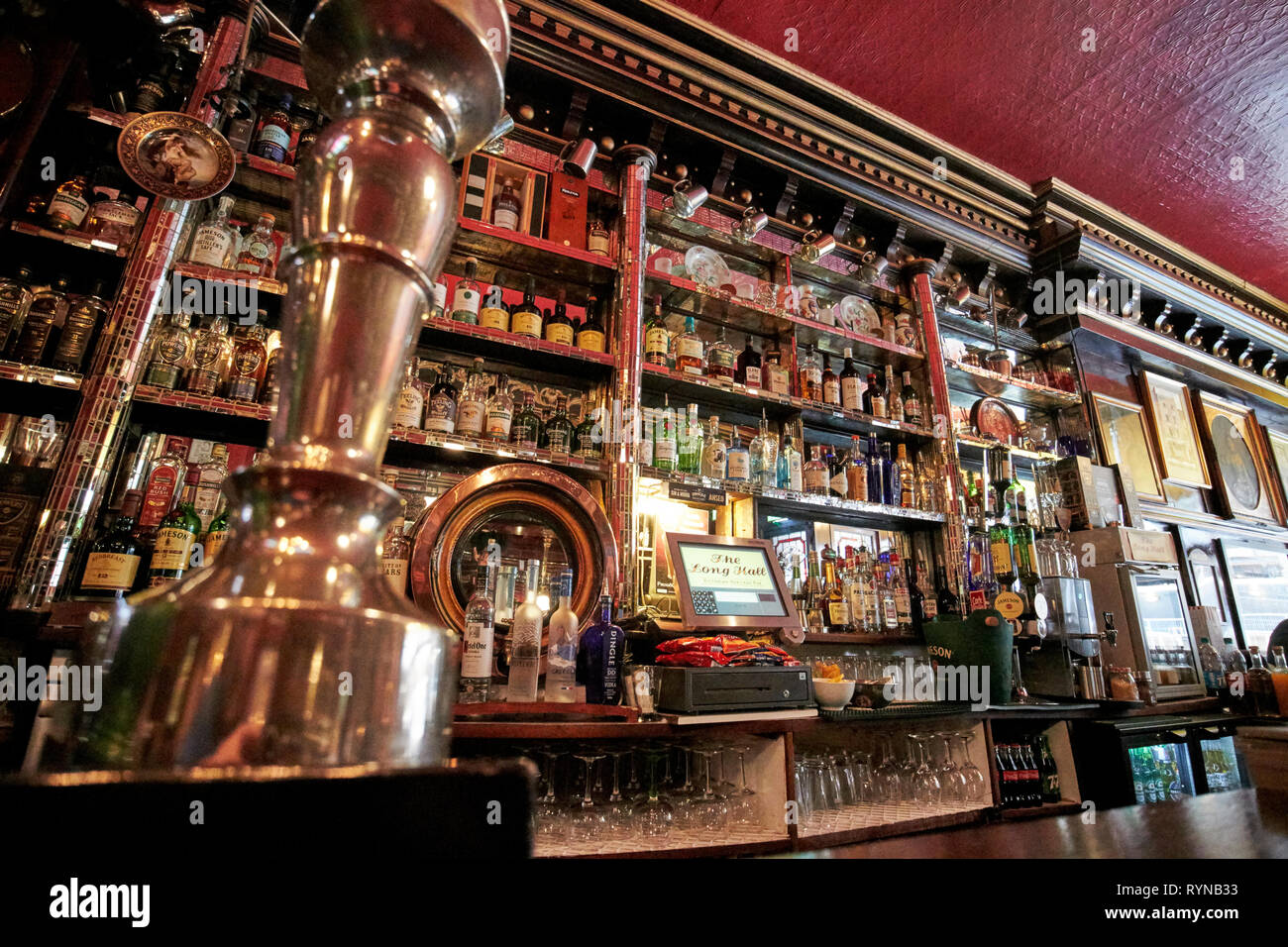 draft beer pumps in The Long Hall victorian pub one of the oldest pubs in Dublin republic of Ireland - Stock Image