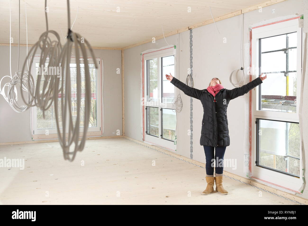 A Happy Woman in a new construction enjoying live Stock Photo