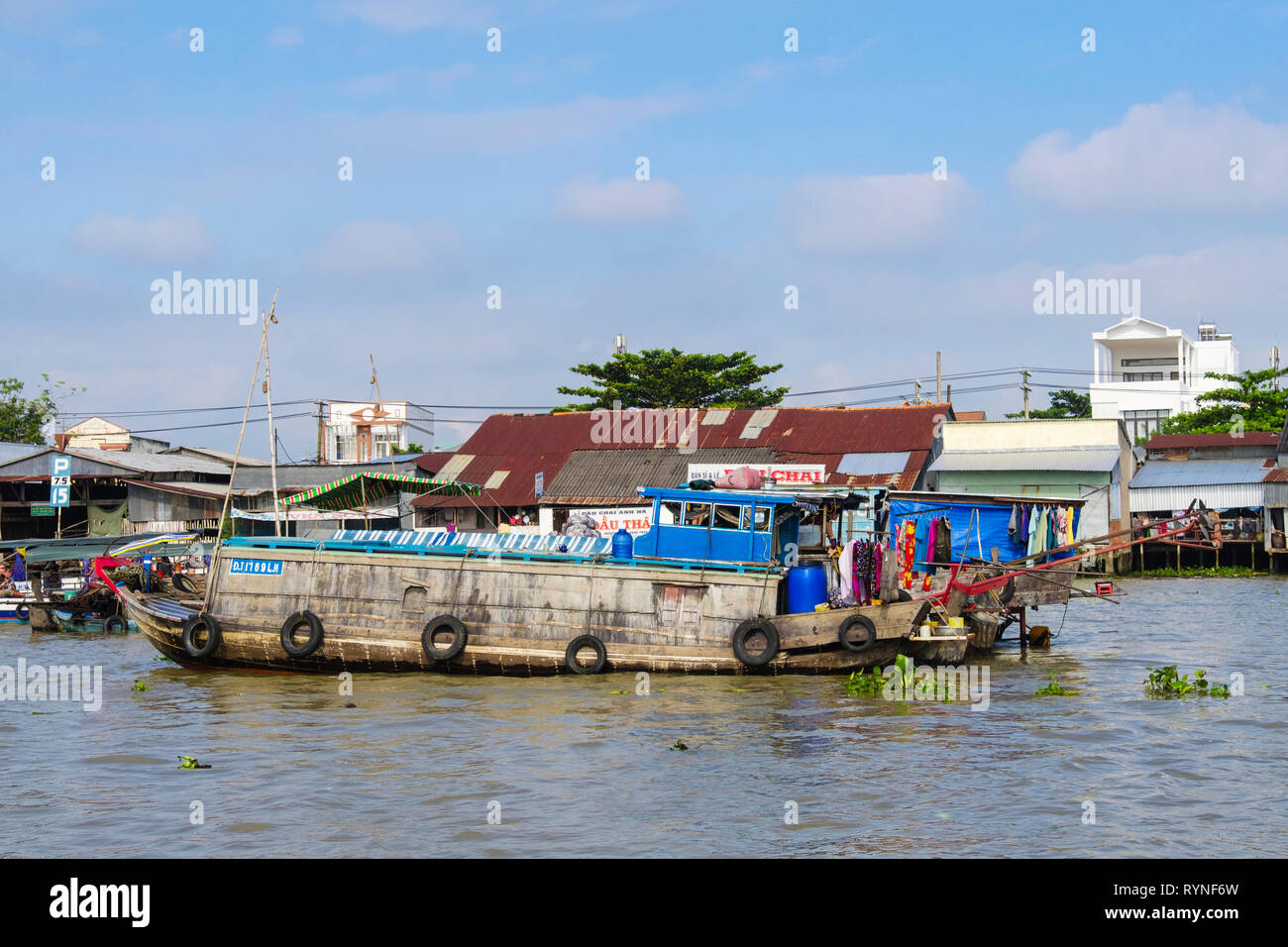 Traditional house boat in the floating market on Hau River. Can Tho, Mekong Delta, Vietnam, Asia Stock Photo
