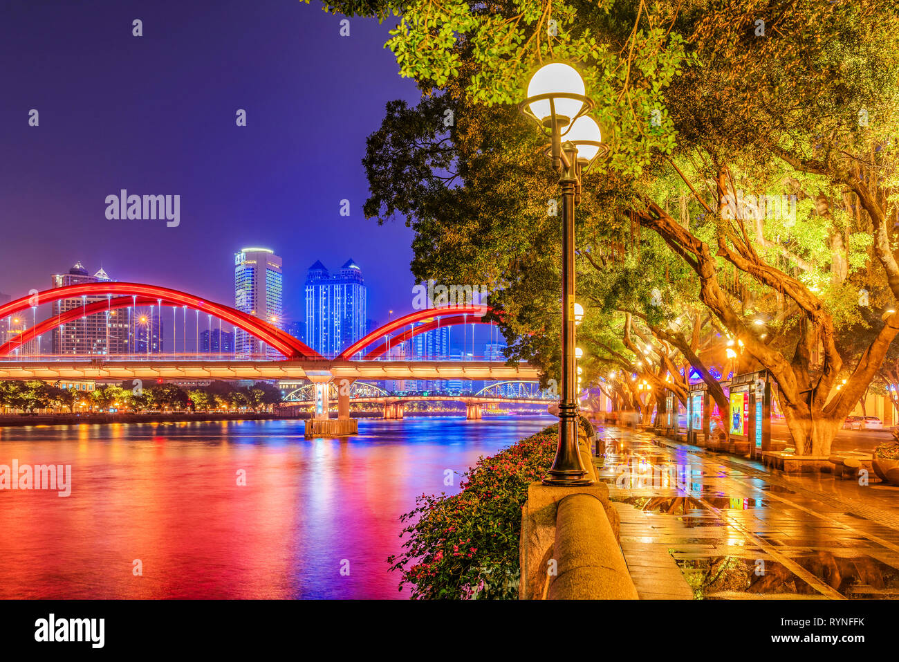 GUANGZHOU, CHINA - OCTOBER 24: Night view of riverside park and the fanous Jiefang Bridge along the Pearl River on October 24, 2018 in Guangzhou - Stock Image