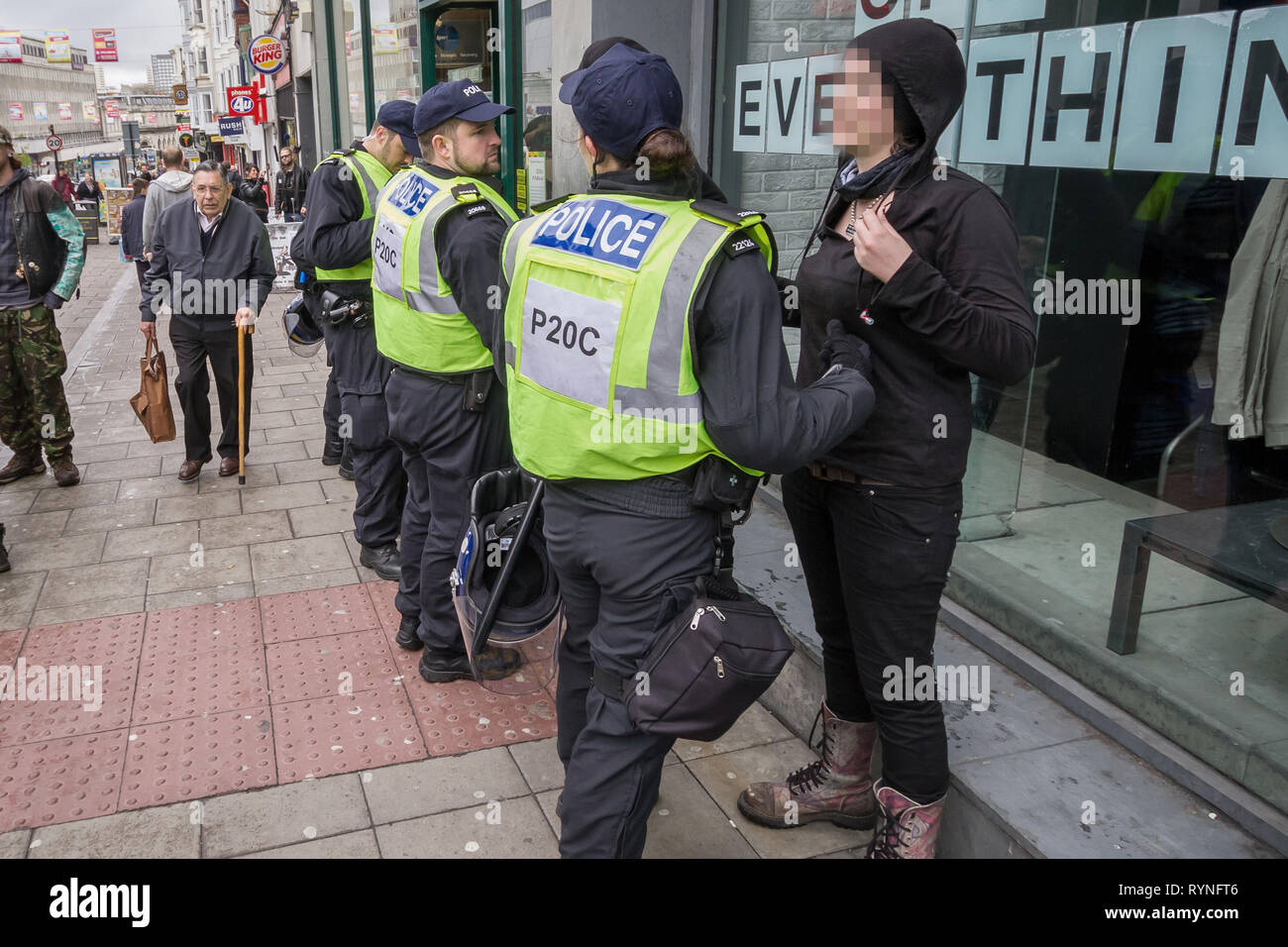 Stop and search procedures on anti-fascist protesters in Brighton, UK - Stock Image