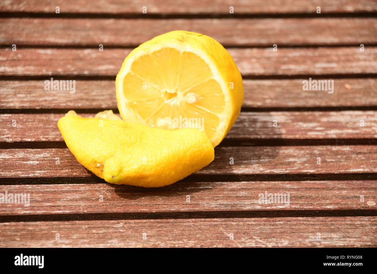 divided lemon on the table - healthy and delicious food - Stock Image