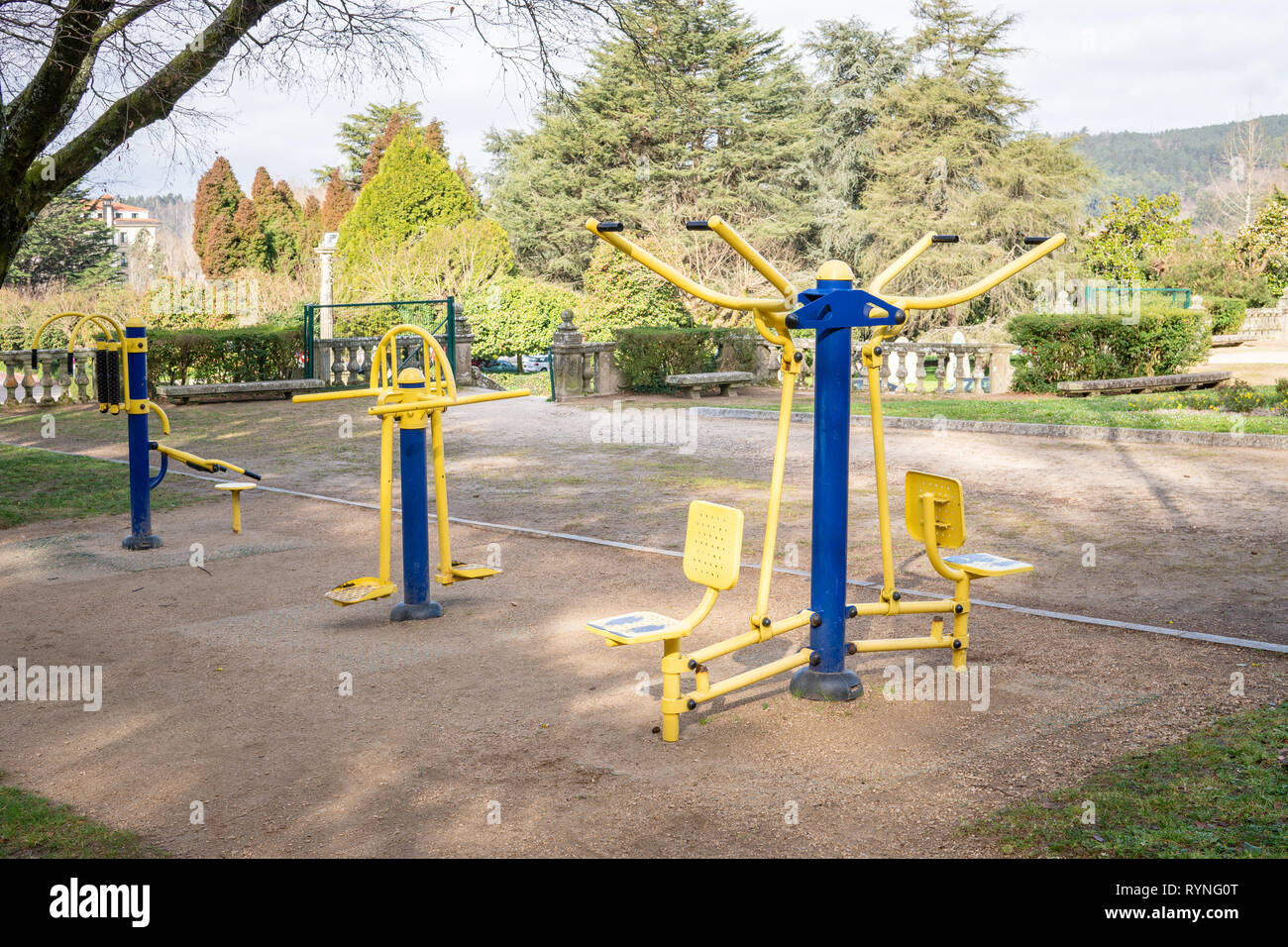 Outdoor exercise machines at public park. - Stock Image