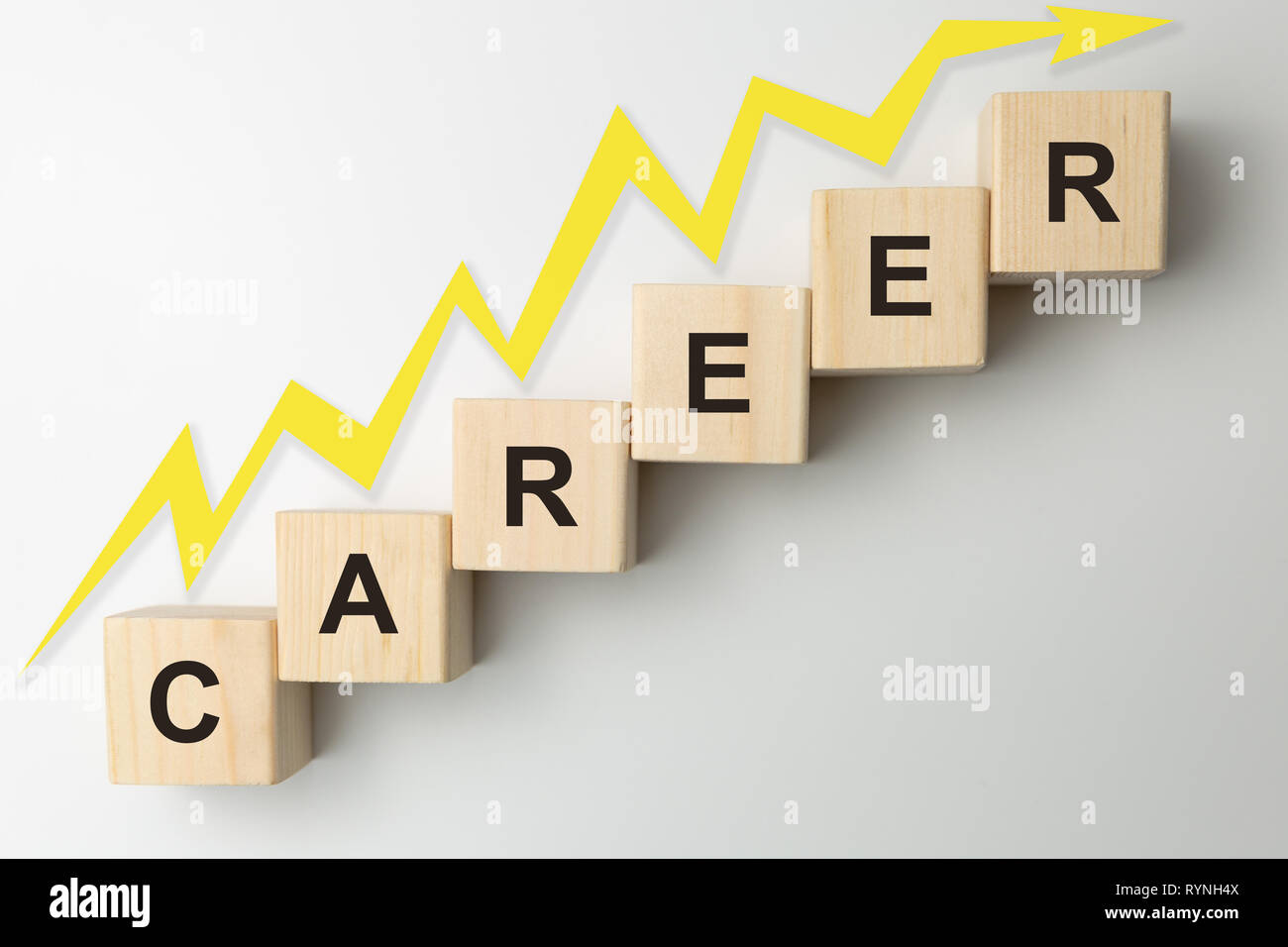 Wooden blocks arranged in stair shape with the word CAREER. Arrow pointing up - Stock Image