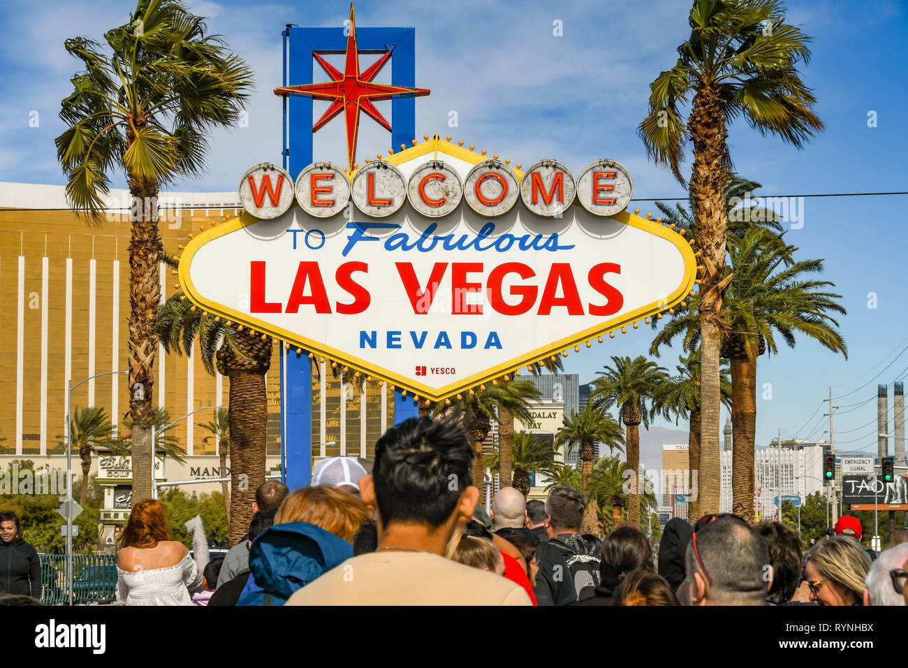 """LAS VEGAS, NV, USA - FEBRUARY 2019: People queuing to have their picture taken in front of the famous """"Welcome to Las Vegas"""" sign. Stock Photo"""