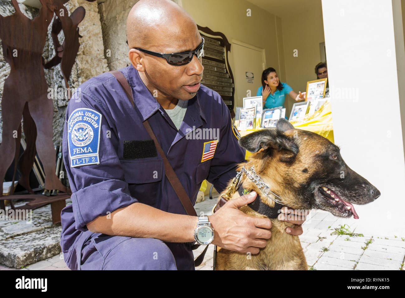 Miami Florida Temple Israel Bow-Wow Palooza Interfaith Blessing of the Animals owner dog canine FEMA Urban Search and Rescue Bla - Stock Image