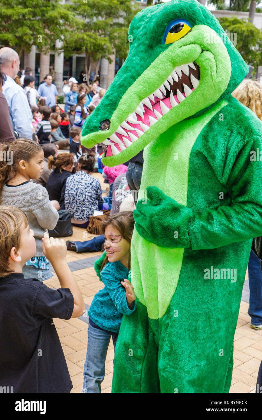 Miami Florida Adrienne Arsht Center for Performing Arts Free Family Fest festival literary character alligator green costume boy - Stock Image