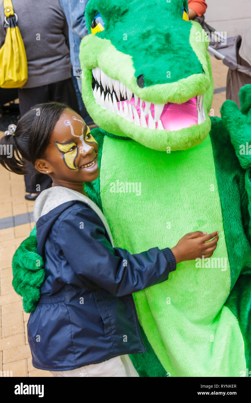 Miami Florida Adrienne Arsht Center for Performing Arts Free Family Fest festival literary character alligator costume Black gir - Stock Image