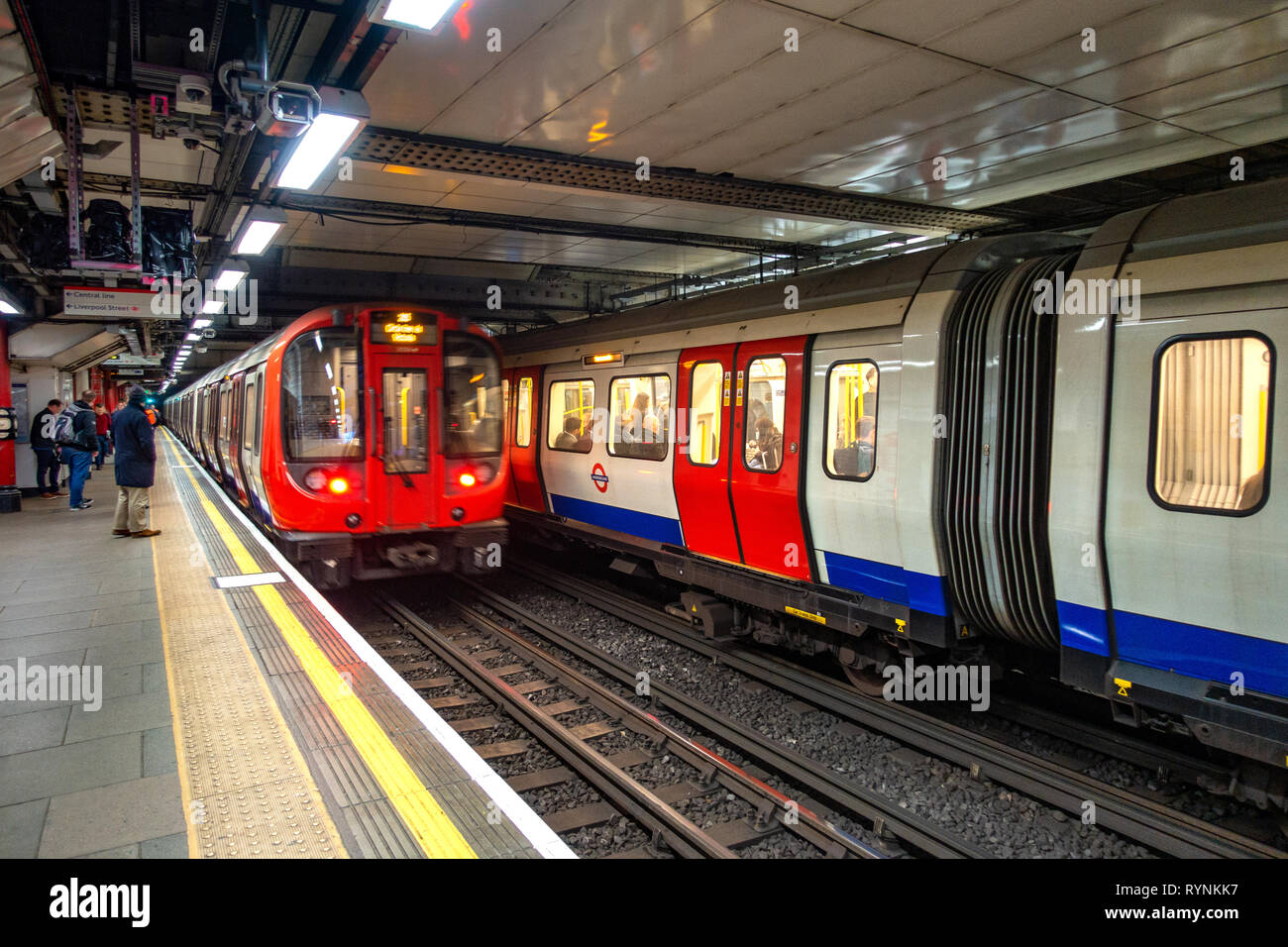 Two London Underground Tube Trains side by side at a platform in London, England - Stock Image