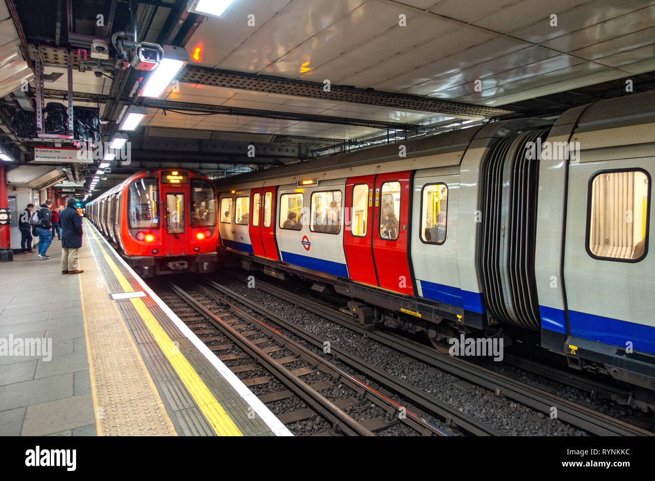 Two London Underground Tube Trains side by side at a platform london underground platform - Stock Image