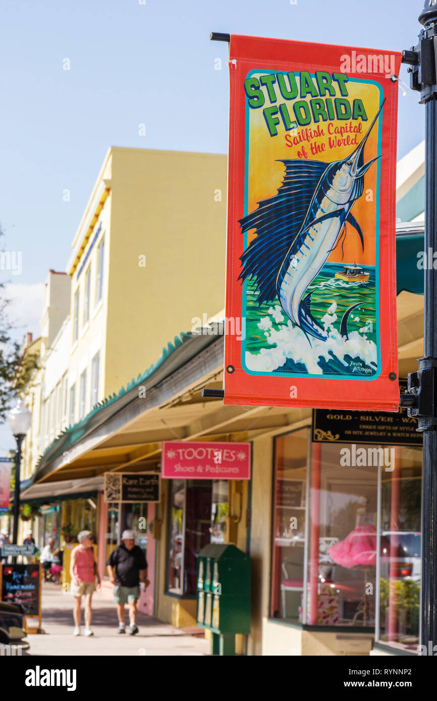 Stuart Florida Historic Downtown Flagler Avenue banner business district man woman couple walking shops shopping store window sa - Stock Image