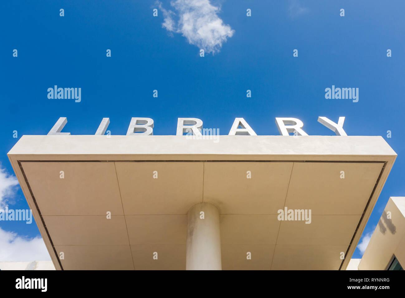 Miami Beach Miami Florida Beach Public Library sign exterior metal letters entrance building portico sky design - Stock Image