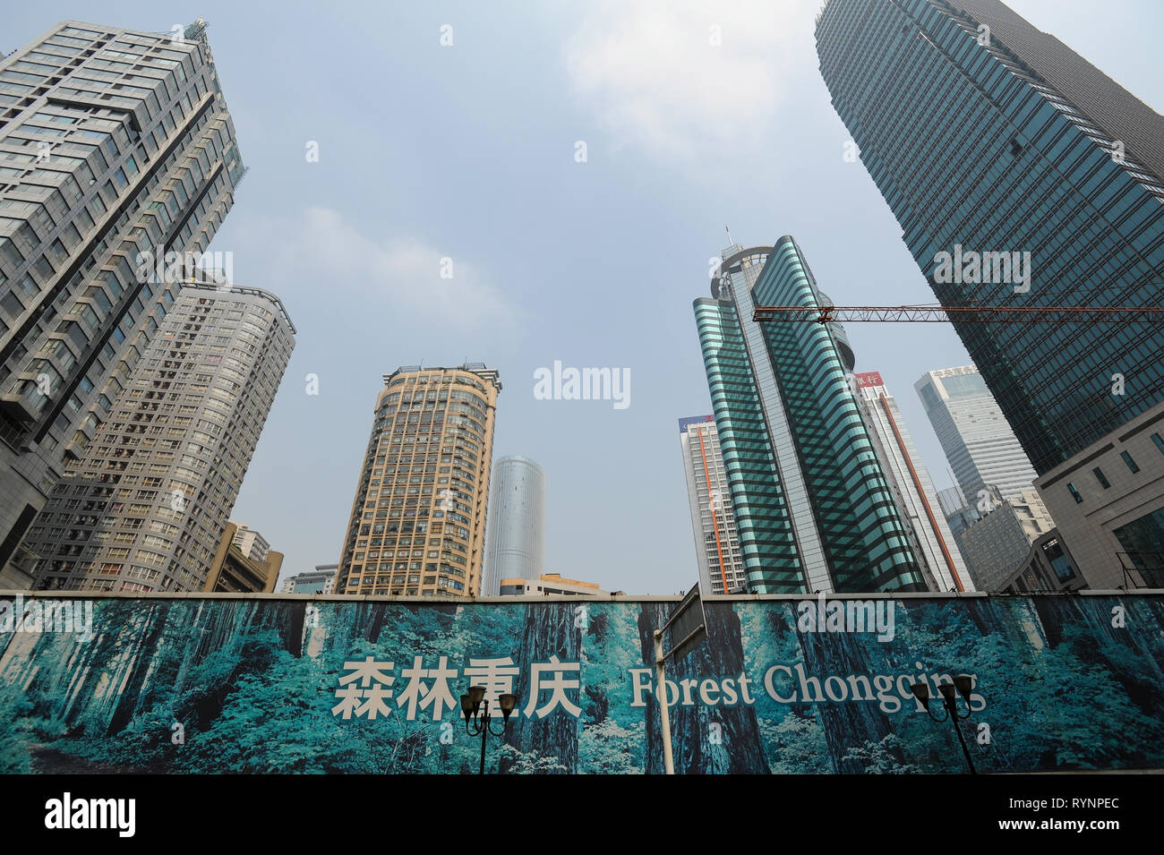 03.08.2012, Chongqing, China, Asia - A view of a construction site with modern high-rise buildings in the city centre of the megacity. Stock Photo