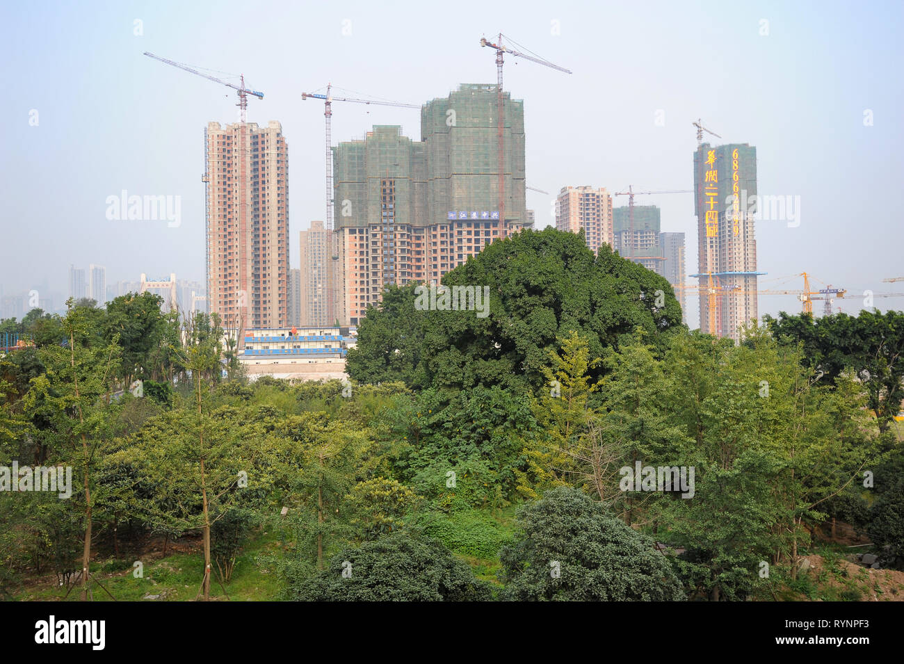 03.08.2012, Chongqing, China, Asia - View of a construction site with new high-rise apartment buildings outside the city centre. Stock Photo