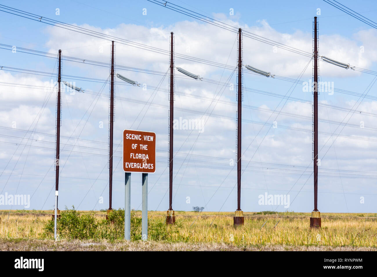 Everglades Florida Alligator Alley Interstate 75 saw grass sign scenic view utility poles wires crisscrossing human intrusion ec - Stock Image