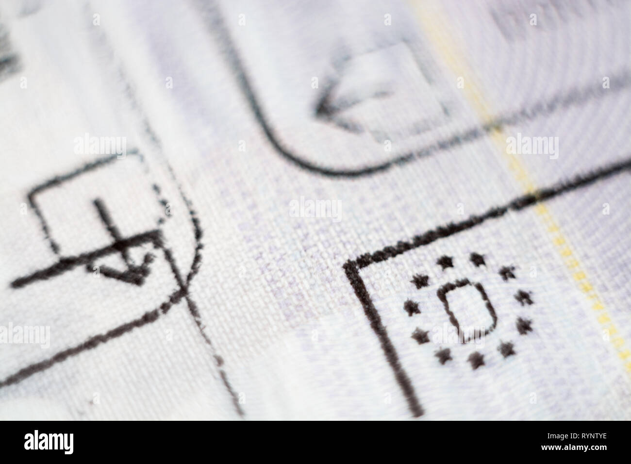 Close-up macro detail of European Union border control customs admission stamp with exit symbol in focus and Germany country sign Stock Photo