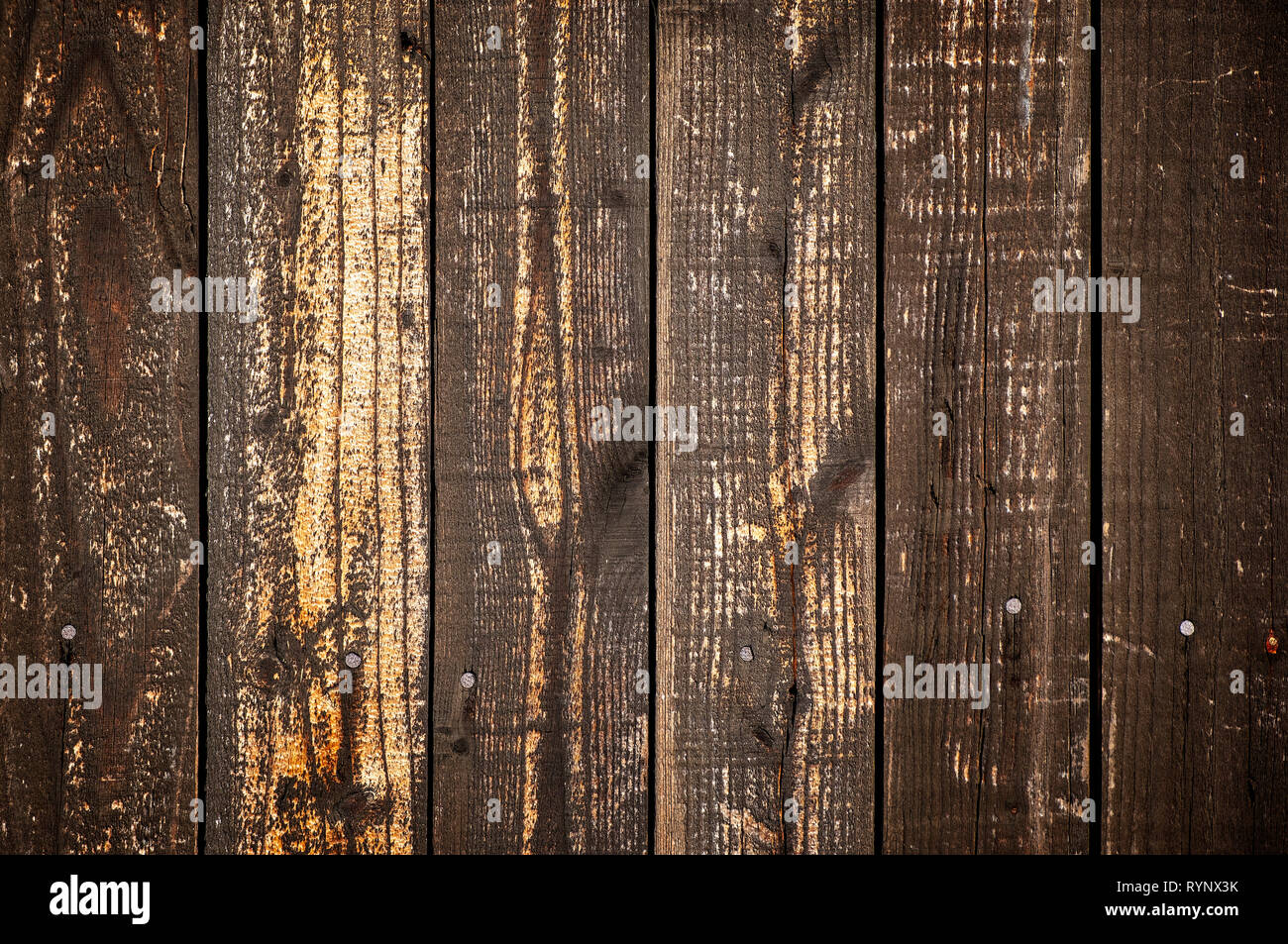Dark wooden planks wall background striped vertically - Stock Image