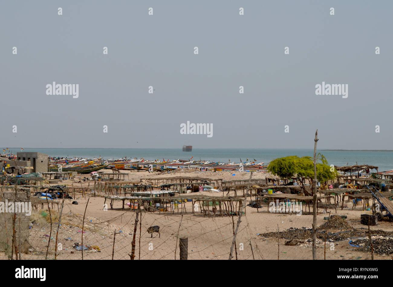 Sardinella landing and drying areas in the coastal village of Djiffère, Senegal Stock Photo