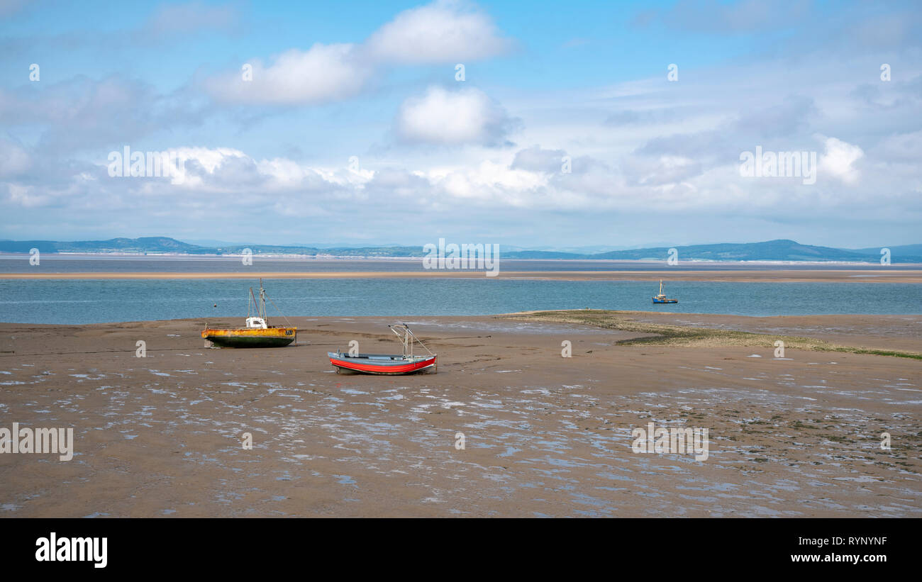 Views around Morecambe bay of the Beach,Tern Project bird sculptures and Eric Morecambe Statue on the central promenade and Lake District Hills behind - Stock Image